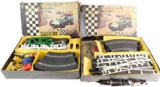 Two Scalextric model motor racing sets, lacking cars, boxed. (AF)