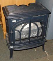 A cast iron gas stove heater, model Jotul GF300CF.