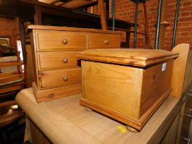A pine miniature chest of drawers, together with a pine casket. (2)