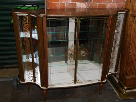 A 1960's glazed and gilt decorated china cabinet.