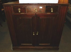 An early 20thC pine corner side cabinet, later converted to a television stand.