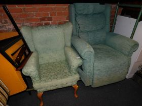 An electric reclining armchair, in green chenille, together with another armchair. (2) The upholster