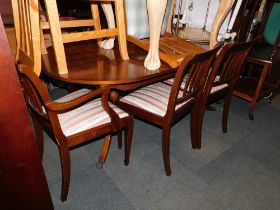 A reproduction mahogany dining table, together with five chairs. (6) The upholstery in this lot does