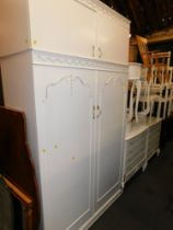 A French style cream painted bedroom suite, comprising two dressing tables and stools, two chests, w