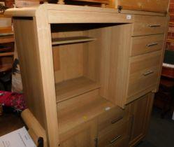 An oak effect desk with steel handles.