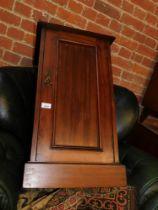 A Victorian walnut pot cupboard.