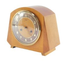A Smiths Enfield mid century mantel clock, circular dial with brown chapter ring bearing Arabic nume