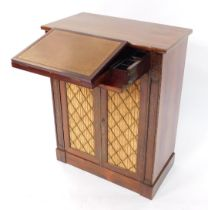 A Regency rosewood secretaire chiffonier, the secretaire drawer opening to reveal a tooled leather r
