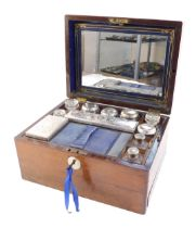 A Victorian rosewood fitted vanity box, containing cut glass bottles, jars and boxes with plated lid