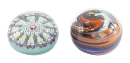 A concentric millefiori glass paperweight, 7cm diameter, together with a Wedgwood glass paperweight
