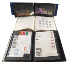 Philately. Hong Kong mint and used, together with first day covers, in three albums.