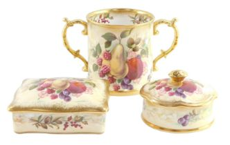 A Hammersley porcelain loving cup, decorated by D Millington with fruit, signed, together with a sim