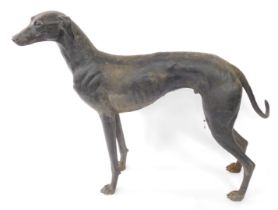 A large spelter figure of a greyhound, modelled in standing pose, head to the left, 95cm high, appro