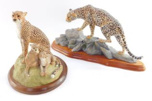 A Harriot Glen design figure group modelled as a cheetah and her cubs, raised on a naturalistic base