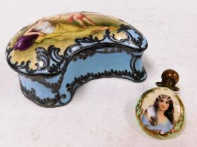An early 20thC continental porcelain box, the lid painted with a reclining female and Cupid with blu