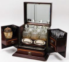 A late 19thC mahogany and rosewood smoker's cabinet or decanter stand, with the top an inlaid shell,