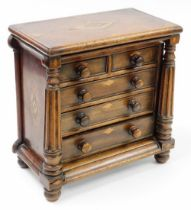 A Victorian apprentice chest of drawers, with two short and three long drawers, with columned suppor