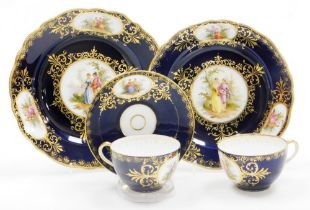 Continental cabinet porcelain, comprising two plates, two cups and one saucer, all with hand painted