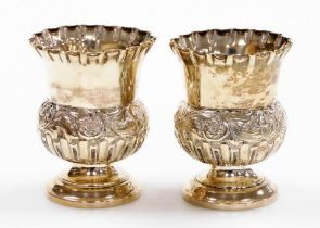 A pair of Edwardian silver thistle shaped vases, with floral crimped borders and embossed flower hea