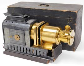 A Helioscopic magic lantern, bearing label for Walker Sylvers, 48 Waterloo Road SE, in an outer wood