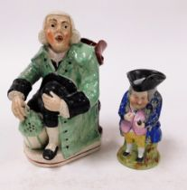 Two Staffordshire character jugs, to include a large Staffordshire potters character jug, of a seate