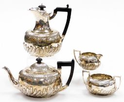 A Victorian neoclassical silver four piece service, makers stamp RM and EH, London 1888, with part f