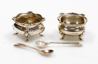 A pair of George V silver salts, each square with fluted body on tripod feet, Birmingham 1918, toget