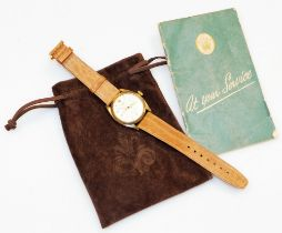 A Rolex Oyster Precision gentleman's wristwatch, in a 9ct gold case, on a tan leather strap, with Ro