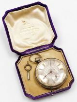 A pocket watch, with heavy elaborate silver coloured dial, and outer gilt scroll detailing, with Rom