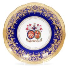 A Minton armorial cabinet plate, with family crest to the centre bearing Latin inscription nec diu n