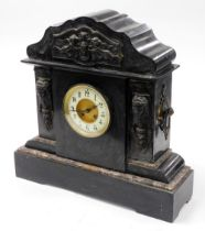 A late 19thC black slate mantel clock, with cherub urn and Medusa carved panels, with a cream dial,