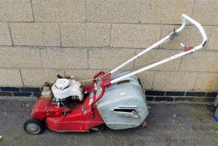 An Asper petrol lawnmower.