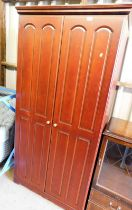 A modern finish double wardrobe, with panelled arch door, and a beech interior.