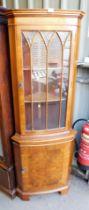 A yew wood corner cabinet.