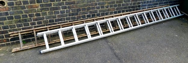 Two extending step ladders, to include one wooden and one metal.