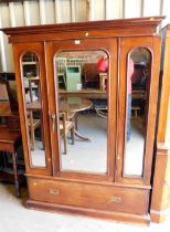 A Victorian mahogany double wardrobe, with central mirrored door and two small panelled mirrored doo