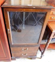 A mahogany finish glazed cabinet with two drawers.