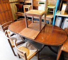 A set of five oak and rush seated dining chairs, and a reproduction twin pedestal dining table.