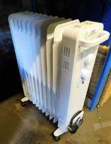A white portable electric radiator.