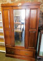 A Victorian walnut single wardrobe with glazed central door above single drawer lacking cornice.