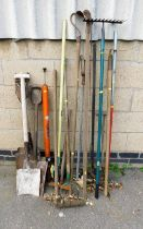 A group of various garden tools, to include rakes, spades, agricultural tools, etc. (a quantity)