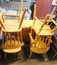 A pine drop leaf kitchen table and four chairs.