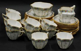 A Shelley part tea service, decorated with leaves, fruit, etc., pattern number 11563, registration