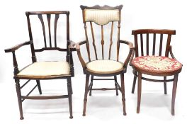 A collection of three Edwardian or early 20thC chairs, each with a padded seat, to include a two