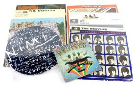 A collection of Beatles LP records, to include Sargent Peppers Lonely Hearts Club band, Help, A Hard