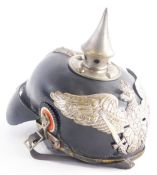 A German leather and silvered metal Pickelhaube helmet, with typical spiked top and badge bearing