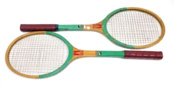 A pair of Russia Olympics wooden tennis rackets, decorated in transfers with the Olympic symbol,
