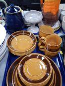 A Kilncraft ironstone part dinner service, orange mottled jug, Denby teapot, collector's plate, etc.