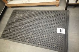 STACK OF 7 VARIOUS SIZE BLACK RUBBER FLOOR MATS 58INCH x 35INCH & SMALLER