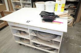 46INCH x 33INCH FREESTANDING WHITE WORKBENCH COMPLETE WITH STOCK OF MISC. EDGE BANDING